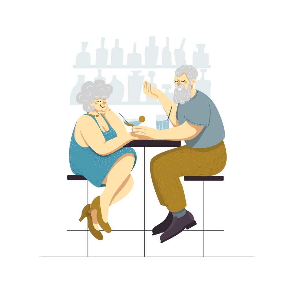 Mann und Frau sitzen in einer Bar und trinken Cocktails