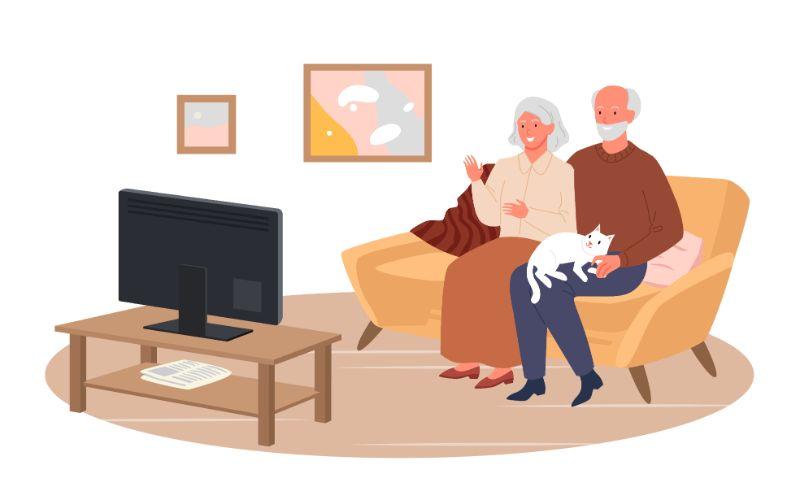 Vektorgrafik von zwei Senioren, die auf einer Couch sitzen und zusammen fernsehen